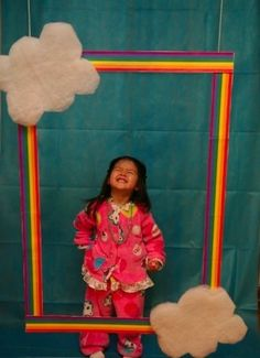 a rainbow photo booth - LOVE this! Create on chalkboard wall, take pics of everyone at party. Did it on the chalkboard, but didn't get to take pics of the kiddos, but still was cute!