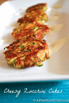 Cheesy Zucchini Cakes Recipe- TRIED IT 10/14/2013- Big hit! Next time I may use a little more Chilli Powder or cayenne to give a little more kick to it. Could also try alternating mozzarella cheeses with cheddar. Finally, may use a southwest ranch also next time vs plain. 4 year old son Loved it- And asked for it in his lunch box =)