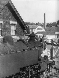 Cars queue as a train crosses the level crossing at Warmley, South Gloucestershire, in 1960 | by brizzle born and bred