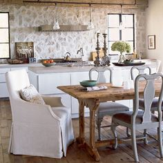 Rustic meets part modern kitchen. Love the wood table, stone walls and mix of dining house design design design designs Stone Kitchen, Rustic Kitchen, Country Kitchen, New Kitchen, Rustic Table, Kitchen Ideas, Cozy Kitchen, Farmhouse Table, Stone Backsplash