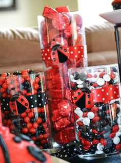 Black and red candy in jars.