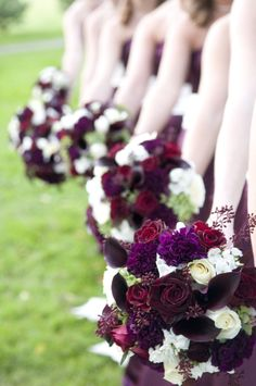 Beautiful combo of roses, carnations and calla lilies for a plum wedding. Love the deep colors with pops of white.