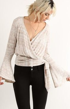 Wrap blouses are sophisticated and sexy. Pair our chicago blouse with waxed denim for a night out.