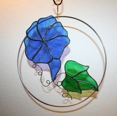 Stained glass suncatcher, blue morning glory flower ring, sale priced. $24.00, via Etsy.