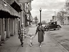Vintage: In the summer of 1936, women in Phoenix Arizona enjoyed a leisurely stroll after surveying the latest hardware and confectionery supplies.  Many suffered from heat exhaustion also..