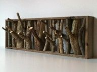 Hooks made from small branches. You'd have to be careful to get branches with twigs that were strong enough.