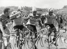 Vittorio Adorni, Gianni Motta and Jacques Anquetil eat spaghetti during a stage of the 1966 Giro d'Italia.
