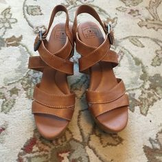 Platform Lucky Brand tan sandals Chunky, fun strappy Lucky Brand platform sandals.  They are actually very comfortable for heels since they are almost wedges.  Some scuffing on the back of the right sandal (see 4th picture).  Price reflects this flaw. Lucky Brand Shoes Sandals