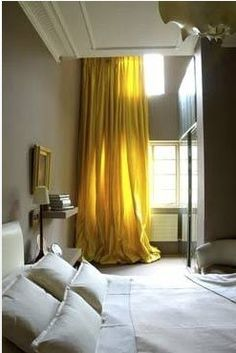 I love these drapes! Maybe not this color....but they make the windows look floor to ceiling.