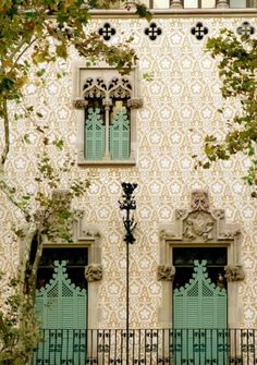 Building facade in Portugal. Love the shutters, doors, patio etc.