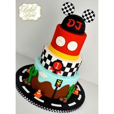 """""""Starting 2016 with a bang!! Our very first cake of the year ❤️❤️❤️ Mickey Mouse Road Rally themed cake for DJ's 1st birthday celebration! #mickeymouse…"""""""