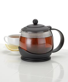 Bonjour Prosperity Teapot | zulily  . $14.99 $30.00  Product Description:  This elegant glass teapot boasts a patented shutoff infuser that traps hydrated leaves below the brewing line to create precisely blended tea. It features a built-in coaster and comfortable handle.      7.5'' W x 7'' H x 6'' D     40.6 oz.     Glass     Heat-safe up to 500°F     Dishwasher safe     Imported
