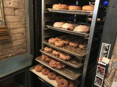 "A photo of trays of fresh warm donuts at Doughnut Vault in Chicago, Illinois.Learn more about this tiny ""hole"" in the wall donut shop by reading the FoodWaterShoes article, ""They're Coming to Take Me Away, Ha Ha! – Doughnut Vault in Chicago, Illinois"" - Food Foodie Foodies FoodPorn Snacks Food Shop Eat Restaurants Local Eats Eating Fried Food Breakfast Brekkie Brunch"