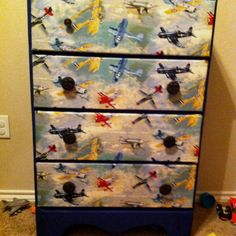 This is in my boys room. I took material and fabric glue and gave their dresser a make over! Super easy to do.
