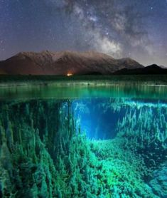 To make this amazing composite image, photographer Johannes Holzer used two cameras, a Sony and Vixen Polarie Startracker to shoot the Milky Way and the mountainous landscape, a Canon to capture the underwater view beneath a frigid German river Beautiful World, Beautiful Places, Wonderful Places, Photos Voyages, Milky Way, Belle Photo, Beautiful Landscapes, Cool Photos, Scenery