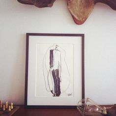 """Suit"" is an illustration made by Dutch artist Petra Lunenburg of a woman in a suit. It's framed in a matt wooden frame with passe-partout.About the artist: Graduated as fashion designer at ARTEZ Arnhem in 1996, Petra has since been working as a graphic designer and illustrator for fashion labels, magazines as well as for her own brand IL'L. Focusing on illustration over the last few years she has developed as a fine artist creating a highly feminine, free..."
