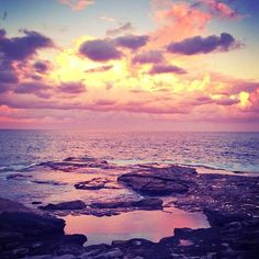 Sunset over a rocky beach.