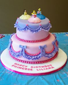 DIL said to design Lily's cake around the Disney princess toppers.  Cake is WASC, white chocolate ganache, MFF fondant.  First time for decorations of fondant, ganache, and covering display board in fondant.  Transported 2 hours by car with no damage whatsoever!  Thanks to all for their helpful suggestions.