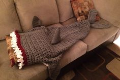A personal favorite from my Etsy shop https://www.etsy.com/listing/256931107/crochet-shark-blanket