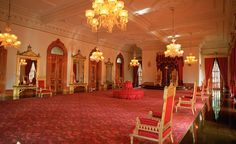'Iolani Palace includes a throne room (pictured), grand hall, and private suites, including the upstairs room where the queen was imprisoned for five months following the 1895 coup. (Stock Connection / SuperStock)