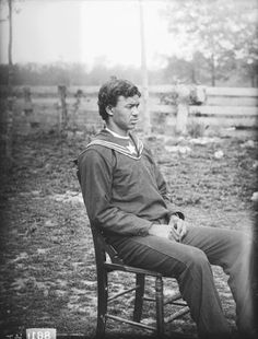 A Chickahominy man in what appears to be a military uniform poses while sitting in a chair. James Mooney took this photograph somewhere in Virginia in 1900. Mooney (1861–1921) was an Indiana native who worked for the Smithsonian Institution's Bureau of American Ethnology compiling information about American Indian tribes.