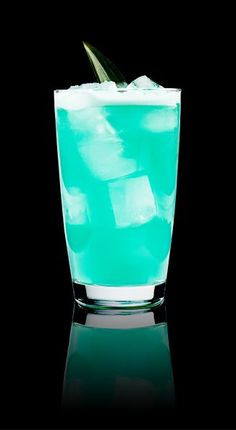 ELECTRIC SHARK - 0.5 oz Captain Morgan™ Original Spiced Rum 1 oz blue curacao 2 oz pineapple juice 2 oz (or top with) ginger beer