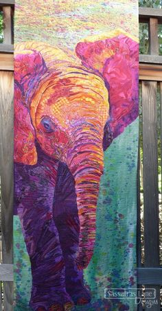 """This is just a short little blog post to show you some quilty eye-candy! I just wanted to show off this gorgeous elephant art quilt made byDarlene Determan. This is an original art quilt and there is no pattern for sale. I am a lucky girl. I get to see quilts like this in person when my Mom (the amazingly talented Kristy of Wolf Creek Quilting) is quilting them.  Quilt Stats Maker / Artist: Darlene Determan Quilting: Thread Painting by Kristy Wolf Size: 20"""" wide by 68"""" tall ..."""