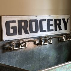 Large metal grocery sign , as seen in Joanna Gaines home