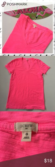J. Crew Hot Pink V Neck Basic Tee Update your wardrobe basics with this Hot Pink V neck tee by J. Crew. Very vibrant color with a slight texture. Similar to a burnout fabric but not so thin (check out that close up!) So easy to wear. Pair with your favorite skinny jeans or throw on some comfy joggers.   ❌ trades ❌ lowballs offer button  Bundle 2 or more items and save 10% J. Crew Tops Tees - Short Sleeve