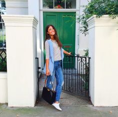 Mimi Ikonn   Ripped light-wash jeans, polka dotted top, sleeveless vest, black bag, and white ASOS sneakers   OOTD