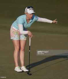 Morgan Pressel talks to Michelle Wie on the green on the eighth hole during the second round of the Yokohama Tire Classic on May 06, 2016 in Prattville, Alabama.
