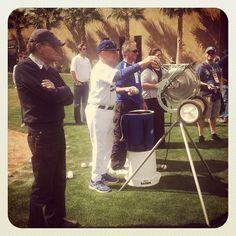 Broadcasting legend Larry King observing Dodger great Maury Wills during bunting practice (taken Mar 11, 2012)