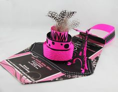 When your party guests receive these invites that I designed, they might think it is just a Purse, but when they open it, a 3-Tier Cake will Pop-Up! How cool is that?Who would not love to attend a party after receiving an invitation as detailed as this one?    Jinky Kowalski  Please check our Portfolio for more unique invitations ideas http://www.jinkyscrafts.com/