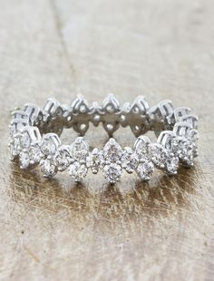 Ava showcases an intricate floral and vintage inspired design set with 3.00 tcw white lab grown diamonds that run all the way around a platinum band.