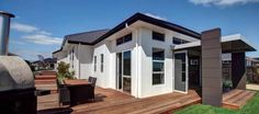 images 576×256 pixels House Cladding, Exterior Cladding, Plaster House, Auckland, This Is Us, Garage Doors, Shed, Outdoor Structures, Mansions