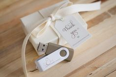swivel grey usb drives with white small box packaging and silk ribbon