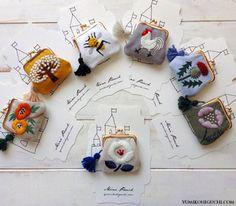 ちょっとした小物を入れておくのに便利なミニポーチ。ウール糸で施された立体感のある刺繍は、お部屋のオブジェにもなりそうです。