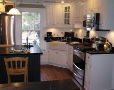 Letošní Nejoblíbenější Kuchyně Měl bílé skříňky, černými prvky, plovoucí police nebo Uber-organizovaný přípravny