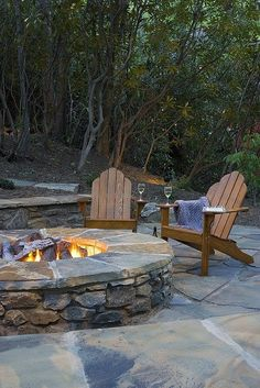 Put your feet up, watch the flickering flames and stay warm with this #outdoor patio surrounded by forest.~ 50 Stunning Outdoor Living Spaces - Style Estate -
