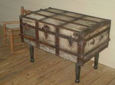 Add legs to an old trunk and make it into a cool side table