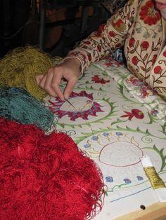 embroideress of suzani textile, silk embroidery with natural dyes, uzbek tribal art, Uzbekistan