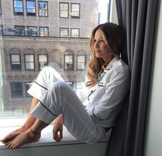 Is this the secret to her eternal youth? Elle Macpherson, 52, preaches the benefits of a good night sleep as she poses in her pajamas on a windowsill