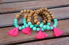 These Bracelets features agate and wooden beads. Pink Tassel Attached. *Handling time 2-3 Business days