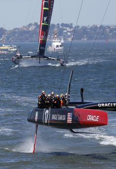 America's Cup - September 25, 2013  Oracle Team USA crosses the finish line to clinch victory over Emirates Team New Zealand in the America's Cup competition Wednesday on San Francisco Bay in the final, winner-take-all race.
