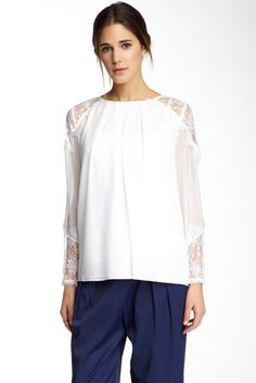 Nordstrom Rack: This is a long sleeve Alice + Olivia blouse with sheer embroidered lace on the shoulders and on the bottom of the sleeves. Embroidered lace is perfect for a feminine look! I love lace! This blouse can be paired with a pair of light pink skinny jeans and nude pumps for a feminine/ casual outfit. For a bold look, a pair of cobalt blue skinny pants and leopard print ankle strap heels!