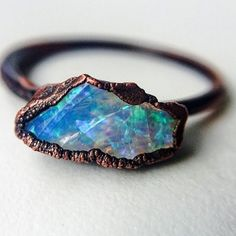 Australian Opal and Copper ring by Indie and Harper. I love the contrast between the dark rough copper and the pastel delicate Opal. /////// #whyiloveminerals  www.indieandharper.com