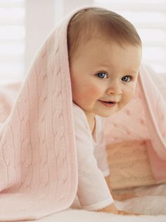 Wrap your baby in the sweater-like softness of richly cabled, plush mercerized cotton that looks like a treasured heirloom.
