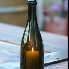 Wine bottle candles... Love these
