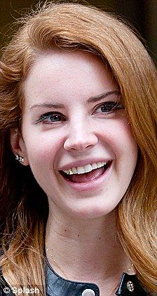 Lana Del Rey ditches her gold tooth cap for a silver sparkly version 88b7b5aa8