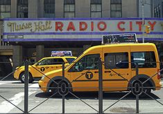 Radio City Music Hall. Photography by Andrea Rea. Taxis line the street in front of the iconic Radio City Music Hall in New York City in this classic street scene. Original work available as framed print, canvas, and more only on Fine Art America and Pixels.com. https://andrea-rea.pixels.com/